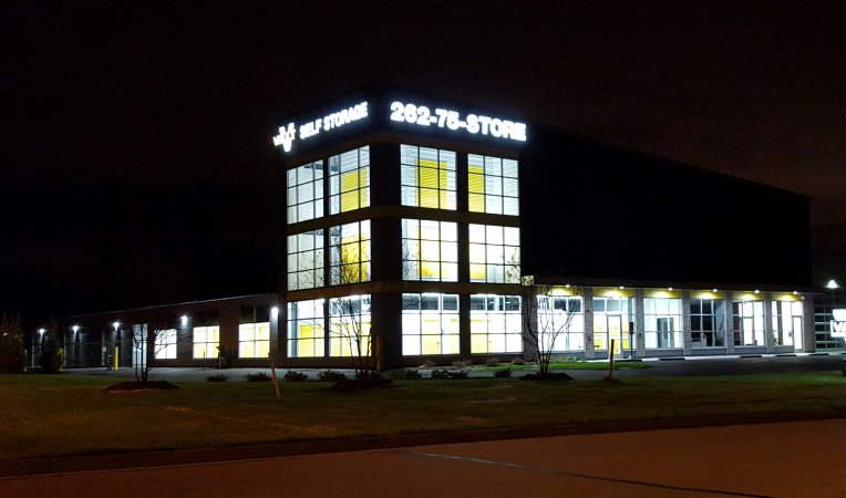 Exterior of self-storage building at night