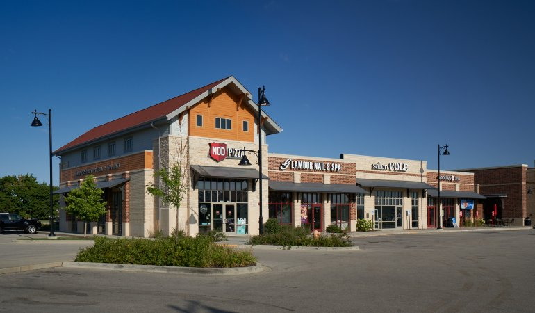 Exterior of strip mall with Qdoba restaurant